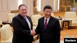 U.S. Secretary of State Mike Pompeo shakes hands with Chinese President Xi Jinping at the Great Hall of the People in Beijing, June 14, 2018.