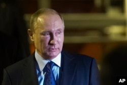 FILE - Russian President Vladimir Putin, pictured in Hamburg, Germany, July 7, 2017, most likely expected the Trump administration would return Russian compounds seized by the previous U.S. administration, veteran diplomat John Herbst says.