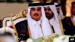 Qatar's Emir Sheikh Tamim bin Hamad al-Thani attends a Gulf Cooperation Council summit in Doha, Qatar, Dec. 9, 2014.