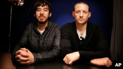 FILE - Recording artists Mike Shinoda, left, and Chester Bennington pose for a portrait, Sept. 16, 2010 in New York.