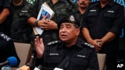 Malaysian National Police Chief Khalid Abu Bakar speaks at press conference in Wang Kelian, Malaysia on Monday, May 25, 2015.