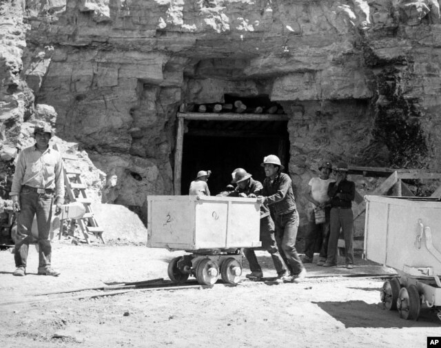FILE - Diné (Navajo) miners work at the Kerr McGee uranium mine at Cove on the Navajo reservation in Arizona, May 7, 1953. (AP Photo)