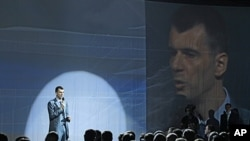 Russian tycoon Mikhail Prokhorov speaks at a meeting of the Right Cause party in Moscow, June 25, 2011.