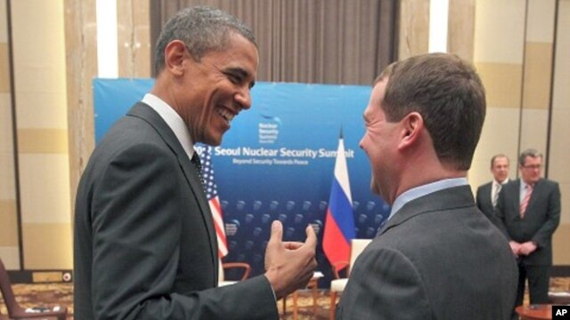 U.S. President Barack Obama, left, and Russian President Dmitry Medvedev talk and smile at each other following the conclusion of their bilateral meeting at the Nuclear Security Summit in Seoul, South Korea,  March, 26, 2012.