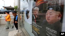 "A South Korean news magazine with front cover photos of U.S. President Donald Trump and North Korean leader Kim Jong Un, right, and a headline ""Korean Peninsula Crisis"" is displayed at the Dong-A Ilbo building in Seoul, South Korea, Sept. 11, 2017."