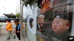 "FILE - A South Korean news magazine with front cover photos of U.S. President Donald Trump and North Korean leader Kim Jong Un, right, and a headline ""Korean Peninsula Crisis,"" is displayed at the Dong-A Ilbo building in Seoul, South Korea, Sept. 11, 2017."
