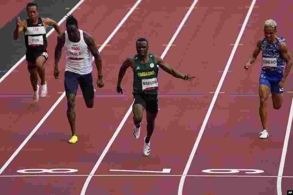 Ngoni Makusha, of Zimbabwe, wins a heat in the men's 100-meter run at the 2020 Summer Olympics, Saturday, July 31, 2021, in Tokyo. (AP Photo/Charlie Riedel)
