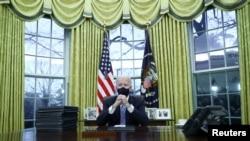 U.S. President Joe Biden signs executive orders in the Oval Office