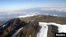 FILE - The peak of Mt. Kilimanjaro is seen from an aircraft in northeastern Tanzania, Oct. 31, 2005.