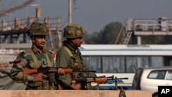 Indian army soldiers take positions outside the airbase in Pathankot, 430 kilometers (267 miles) north of New Delhi, Jan. 2, 2016.