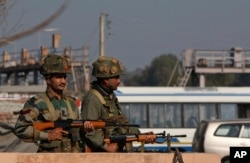 FILE - Indian army soldiers take positions outside the Indian airbase in Pathankot, 430 kilometers (267 miles) north of New Delhi, India, Jan. 2, 2016. At least four gunmen entered an Indian air force base near the border with Pakistan.