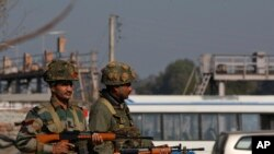 At least four gunmen entered an Indian air force base near the border with Pakistan early Saturday.