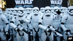 "Over 100 JAKKS BIG-FIGS Stormtrooper action figures are seen as a part of an installation at The Americana at Brand for the opening of ""Star Wars: The Force Awakens,"" in Glendale, Calif., Dec. 17, 2015, in Glendale, Calif. (Danny Moloshok/Invision for JAKKS/AP Images)"