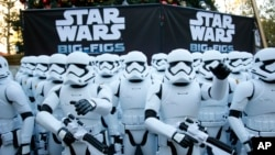 FILE - Over 100 JAKKS BIG-FIGS Stormtrooper action figures are seen as a part of an installation at The Americana at Brand for the opening of Star Wars: The Force Awakens, in Glendale, Calif., Dec. 17.