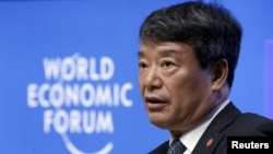 FILE - China's chairman of National Development and Reform Commission Xu Shaoshi speaks during a session at the World Economic Forum (WEF) in China's port city Dalian, Sept. 9, 2015.