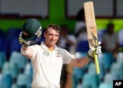 FILE - Australia's batsman Phillip Hughes celebrates after scoring a century.
