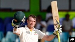 FILE - Australia's batsman Phillip Hughes celebrates after scoring a century.