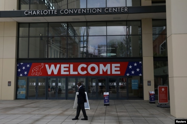 A person walks outside the Charlotte Convention Center, the site of the Republican National Convention, in Charlotte, North Carolina, U.S., August 22, 2020. REUTERS/Leah Millis