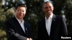 美國總統奧巴馬(右)去年7月在加州與中國國家主席習近平會面。