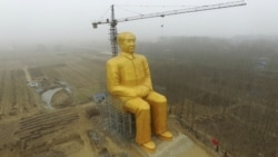 A Sitting Gold Statue Of Mao Not Standing Anymore
