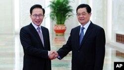 14일 중국 베이징 인민대회당에서 회담한 이명박 한국 대통령(왼쪽)과 후진타오 중국 국가주석.