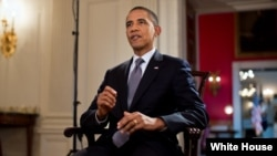 President Barack Obama merekam pidato mingguannya di Gedung Putih, Jumat (17/8).