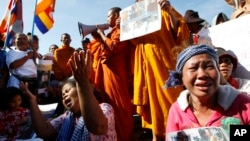 Cambodian land eviction victims and Buddhist monks shout slogans during a rally in front of the National Assembly in Phnom Penh, file photo.
