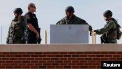 La police d'Oklahoma intervient sur une université à Norman, le 22 janvier 2014.