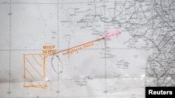 Ðường bay trên một bản đồ trong một cuộc họp báo về các hoạt động tìm kiếm cứu nạn chuyến bay Malaysia bị mất tích.