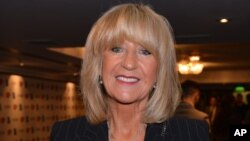 FILE - Christine McVie arrives for the 58th Ivor Novello awards at the Grosvenor House in London, May 16, 2013.