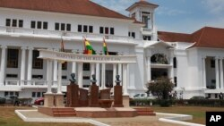 FILE - The Ghana national flag (C) flies in front of the Supreme Court building in the city of Accra, Ghana. The court has ordered the electoral commission to compile new, credible voter list for this year's elections.