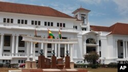 FILE - The Ghana national flag (C) flies in front of the Supreme Court building in the city of Accra, Ghana.