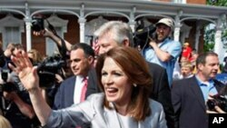 Rep. Michele Bachmann, R-Minn., waves to supporters after making her formal announcement to seek the 2012 Republican presidential nomination, Monday, June 27, 2011, in Waterloo, Iowa. Bachmann, who was born in Waterloo, will continue her announcement tour