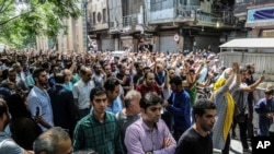 A group of protesters chant slogans at the old grand bazaar in Tehran, Iran, June 25, 2018.