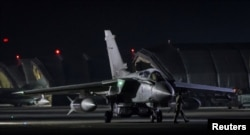 An RAF Tornado taxis to the threshold before taking-off, in Akrotiri, Cyprus, April 14, 2018. (© UK MOD Crown 2018/Handout via Reuters)