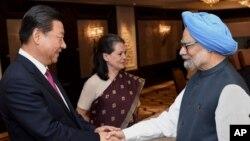 2014年9月19日中國國家主席習近平在印度訪問期間會見了印度前總理辛格。