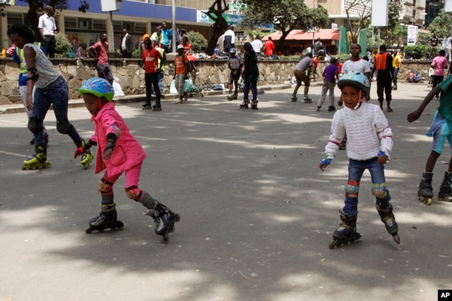 Roller skating is a fun activity to do with family and friends. In this 2015 photo, children and adults skate together in downtown Nairobi , Kenya. (AP Photo)