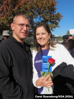 Cathy King holds a rose presented by her son, sailor Devin King, who's stationed at the Washington Navy Yard. An anonymous woman distributed roses to honor active-duty personnel at the Concert for Valor in Washington, D.C., Nov. 11, 2014.