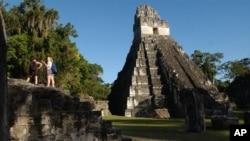 FILE - Tourists are seen at the Mayan ruins of Tikal, 500 kilometers north of Guatemala City, Aug. 20, 2005.