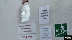 "A face mask of Russian communist revolutionary Vladimir Lenin is seen mounted on a wall at the Vershina-Navigator Foundation's rehabilitation center. The sign beneath reads ""I'm also addicted. Revolution is my narcotic!"""