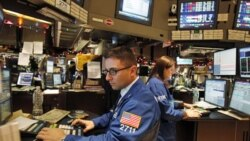 Traders work at the New York Stock Exchange on the last trading day of the year in New York. Registered exchanges, like NYSE Euronext, have seen electronic and alternative exchanges steadily grow