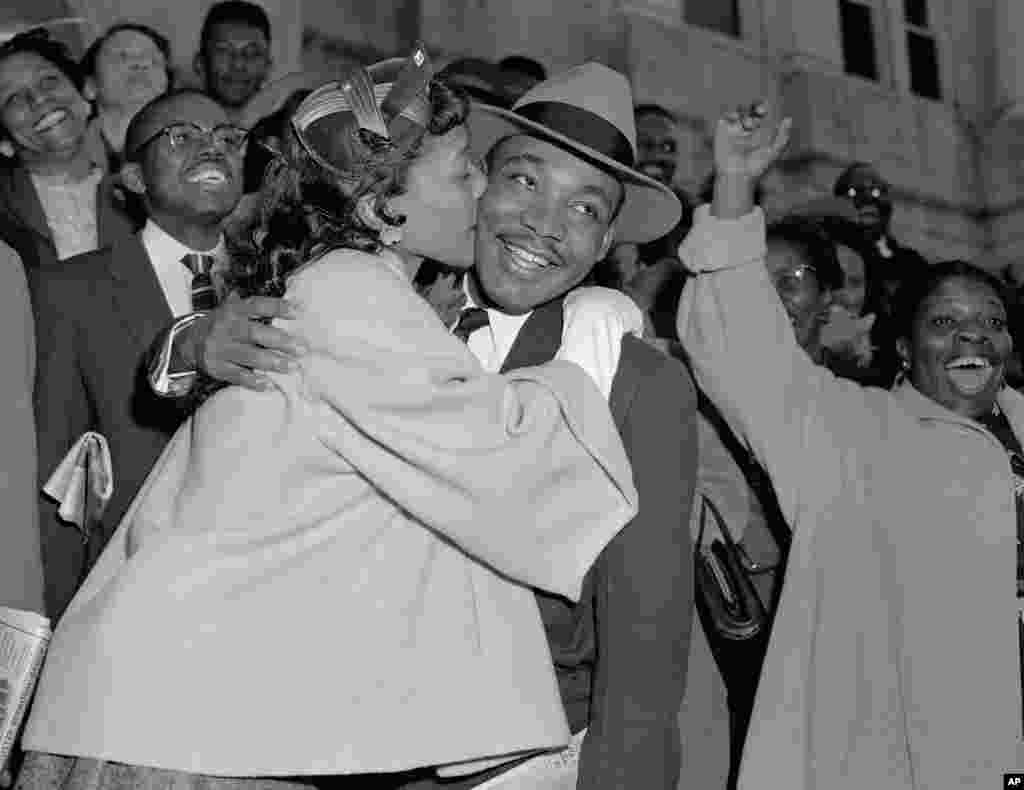 Martin Luther King, Jr. is welcomed with a kiss by his wife Coretta after leaving court in Montgomery, Alabama, March 22, 1956.