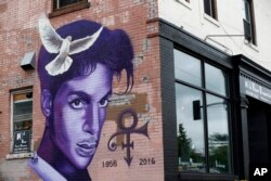 FILE - A mural honoring the late Prince adorns a building in the Uptown area of Minneapolis, Aug 28, 2016. The rock star died of an overdose at the age of 57.