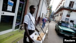 Yurien Roja, 40, sells guava pie bars on the streets in Havana, Cuba, September 5, 2018. Picture taken on September 5, 2018.