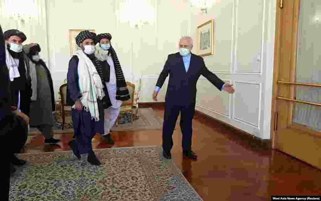 Iran's Foreign Minister Mohammad Javad Zarif meets with Taliban political chief Mullah Abdul Ghani Baradar in Tehran.