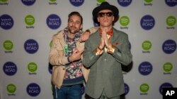 Ryan Lewis and Macklemore pose for photos at the Yahoo! On the Road Concert Series at Turner Hall, May, 12, 2013 in Milwaukee.