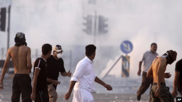 Riot police fire tear gas in Sitra, Bahrain, September 16, 2011.