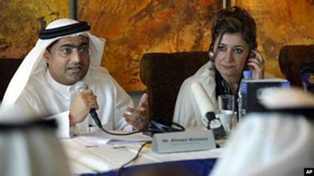 Emirati blogger and human rights activist Ahmed Mansour speaks as the director of Human Rights Watch's Middle East and North Africa division, Sarah Leah Whitson listens on, during a press conference in Dubai, UAE, January 26, 2011