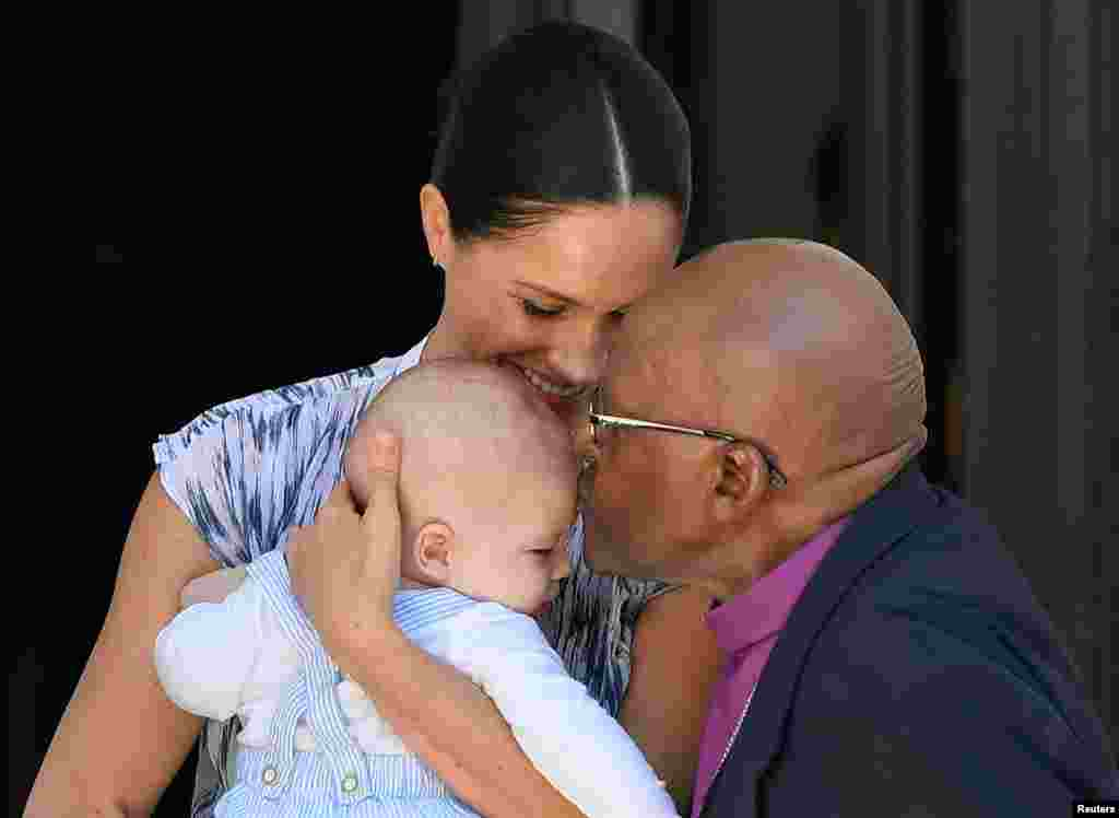 Britain's Meghan, Duchess of Sussex, holds her son Archie, while meeting Archbishop Desmond Tutu at the Desmond & Leah Tutu Legacy Foundation in Cape Town, South Africa.