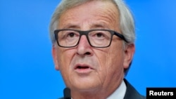 European Commission President Jean-Claude Juncker holds a news conference at the European Council in Brussels, Belgium, Oct. 30, 2016.